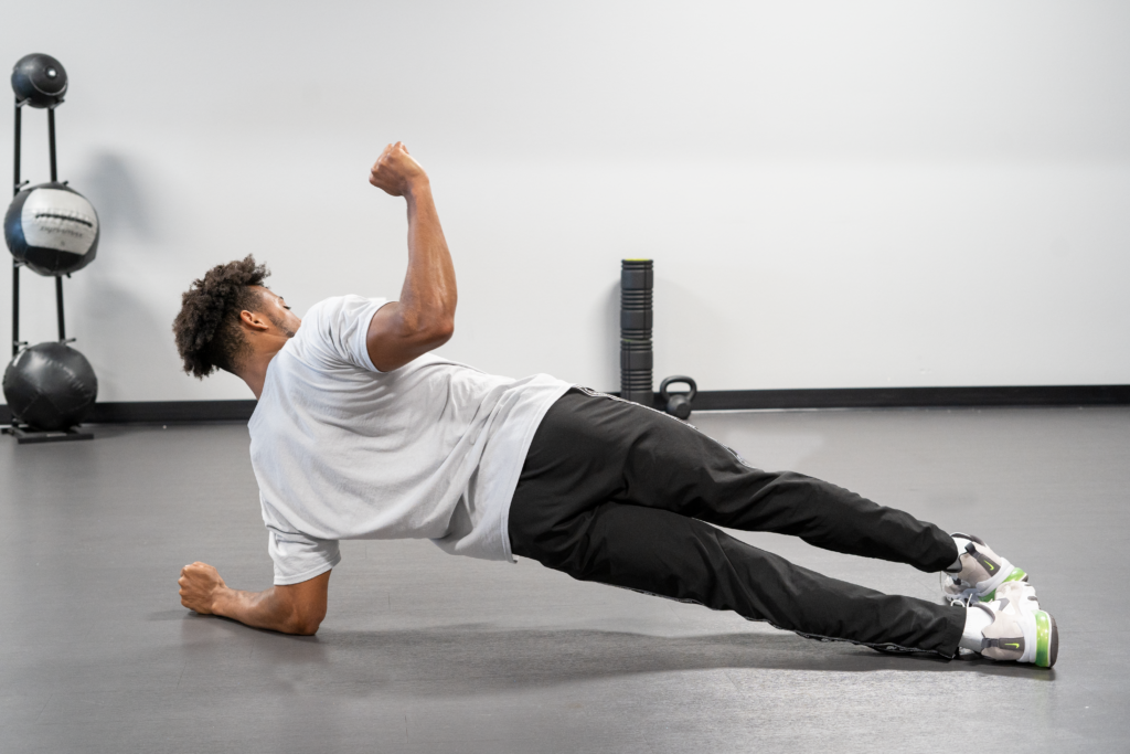 man doing a plank switch