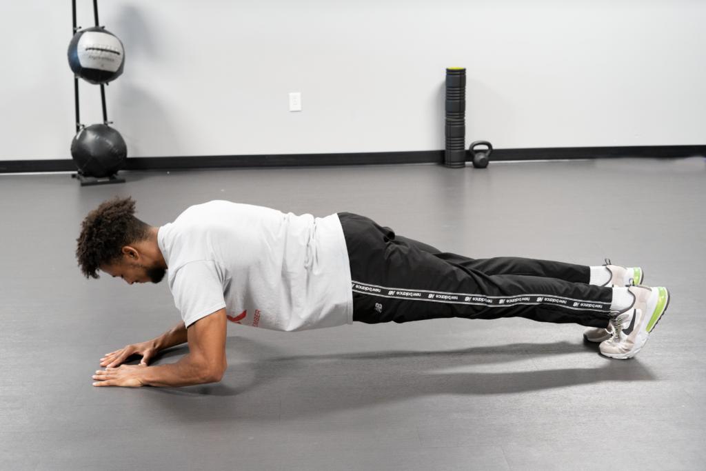 man doing plank push up