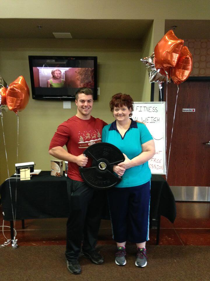 Kelly with her trainer Matt and down 52.8lbs!