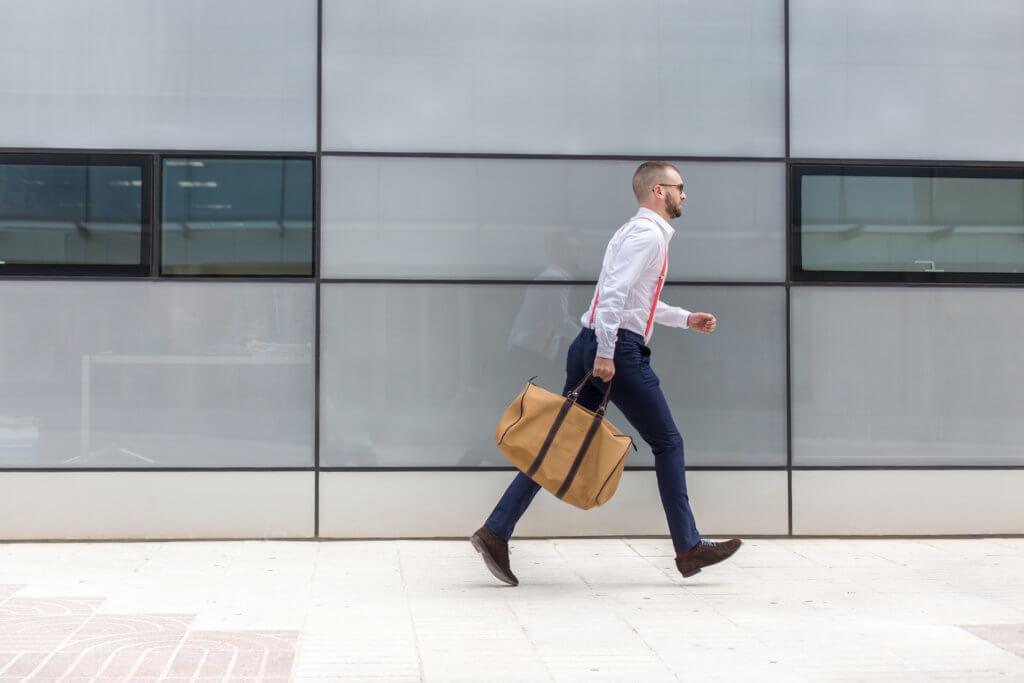 man walking fast to a meeting