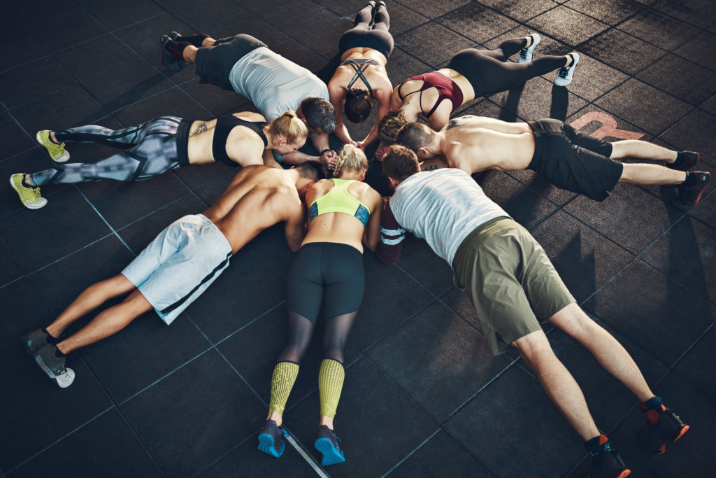 people in a circle plank
