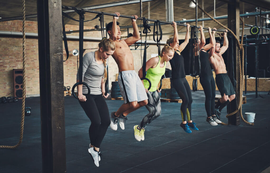 group of people doing pull ups