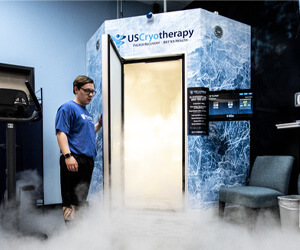 man opens a whole-body cryotherapy chamber