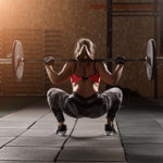 woman with back to camera lifting weights