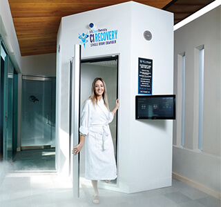 woman steps out of us cryotherapy whole-body chamber