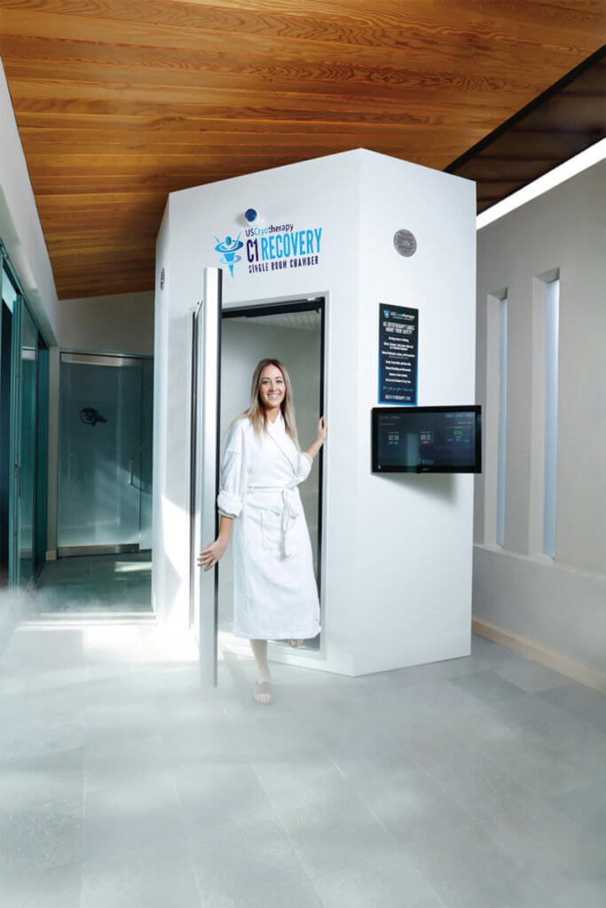 woman stepping out of a us cryotherapy whole-body chamber