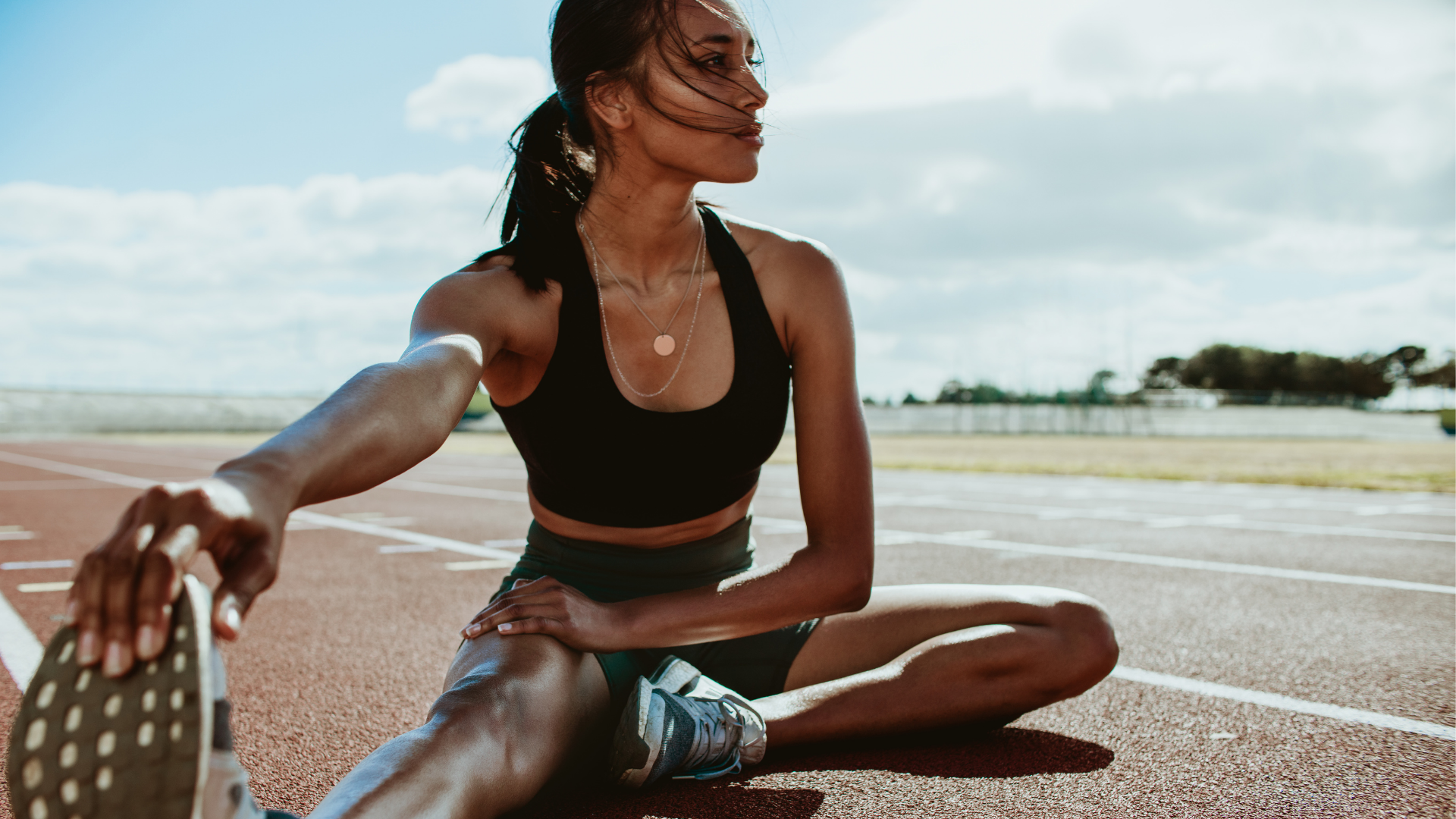 female runner stretching out
