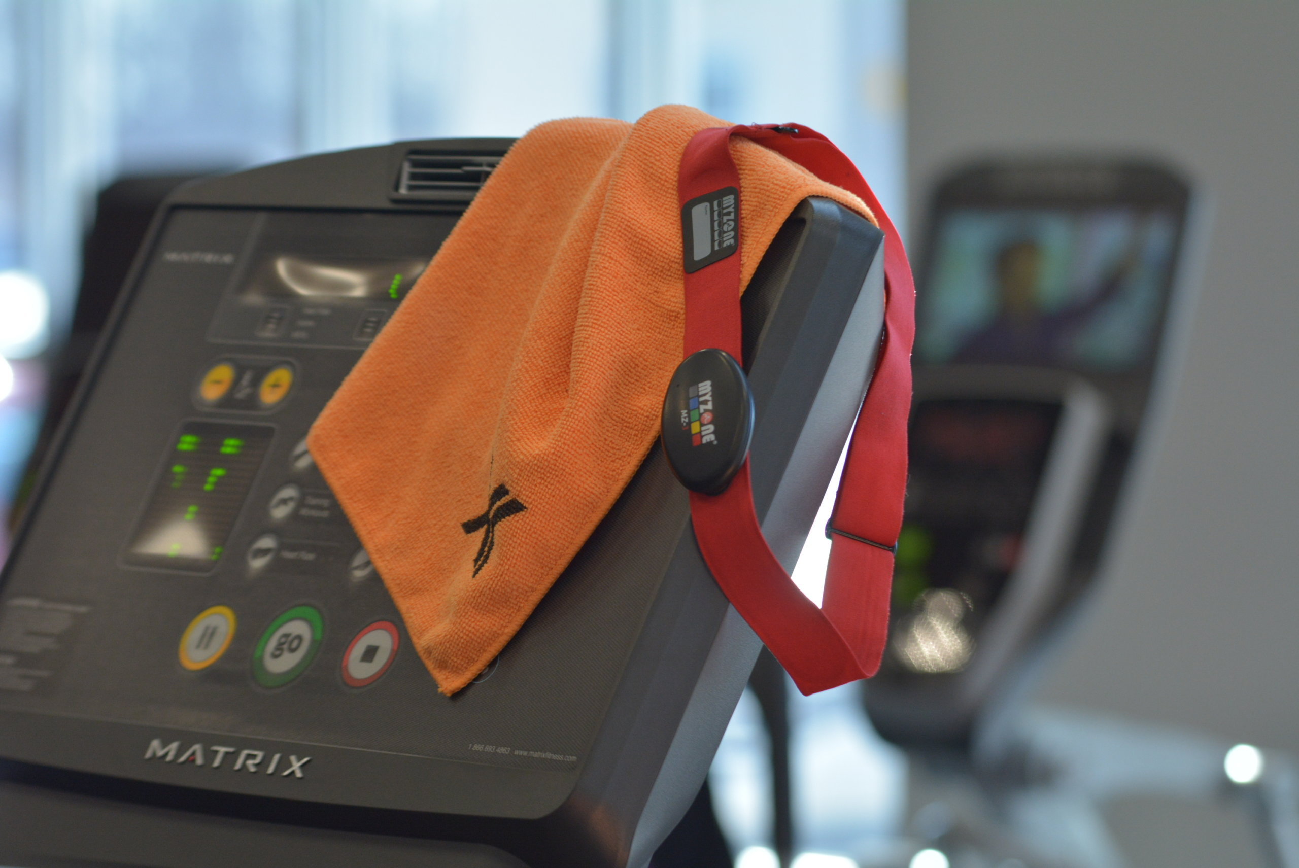 towel and myzone belt on treadmill