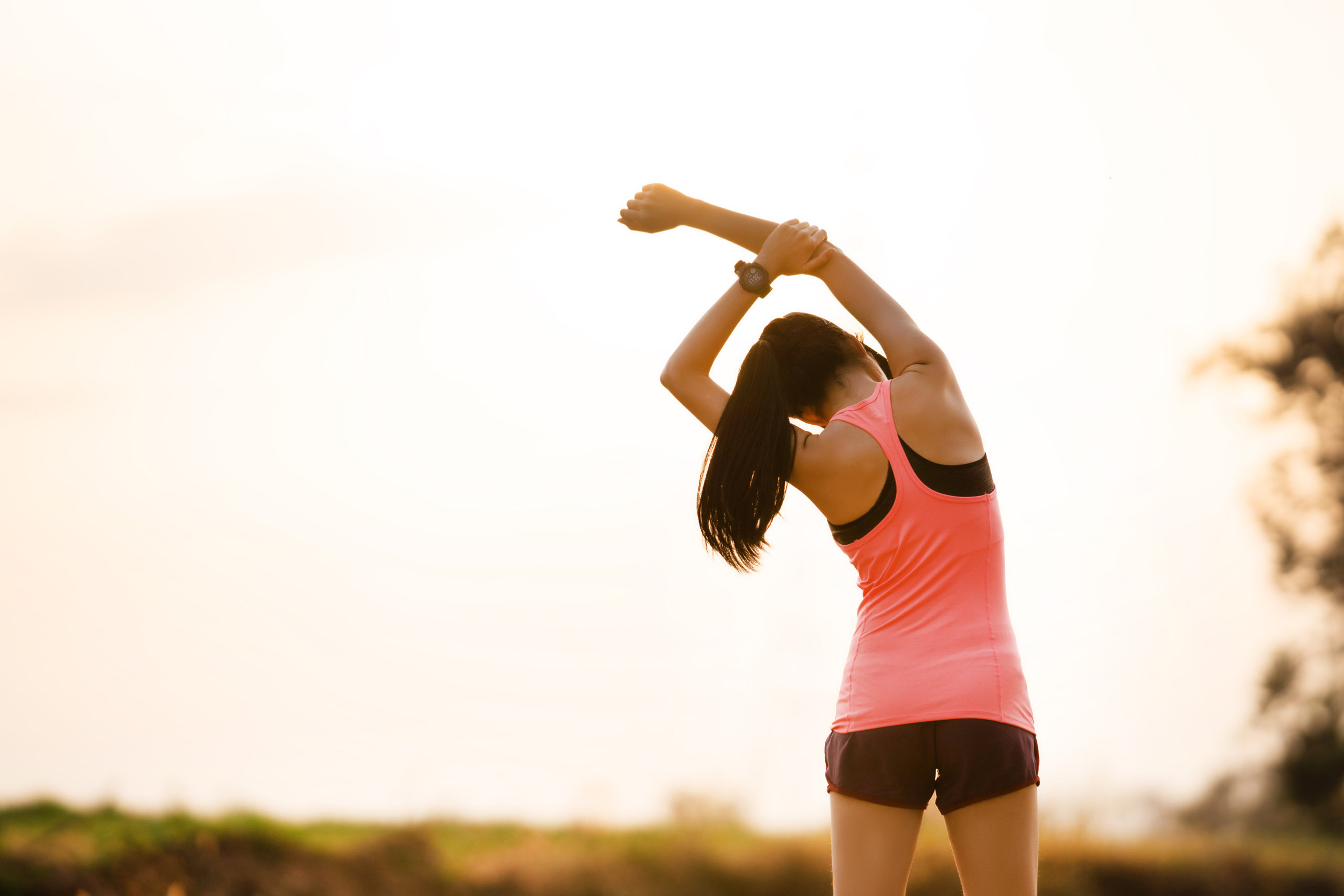 woman stretching to her left