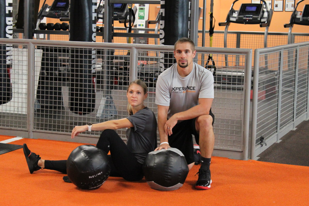 two people sitting in gym