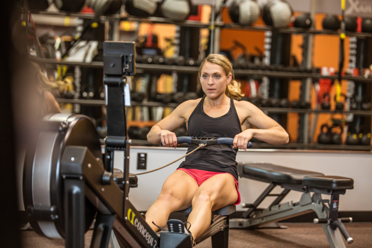 woman sitting in gym working out