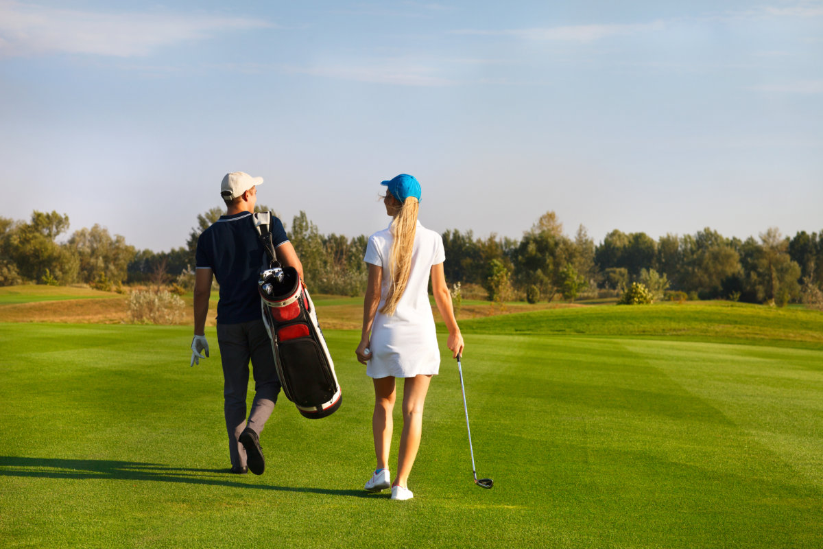 man and woman walking on course