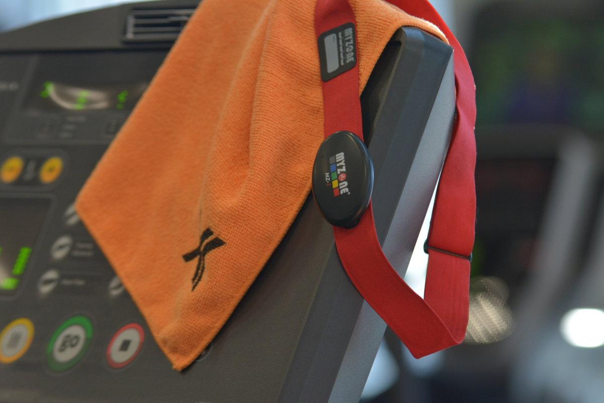 myzone belt and orange towel on treadmill
